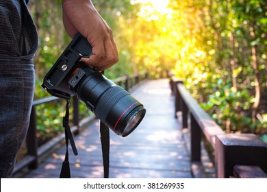 photographer holding his camera.