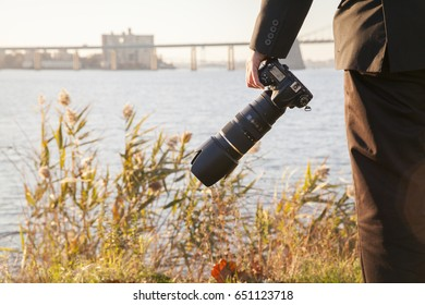 A photographer holding his camera