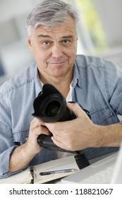 Photographer holding professional camera