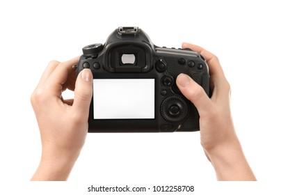 Photographer holding professional camera on white background