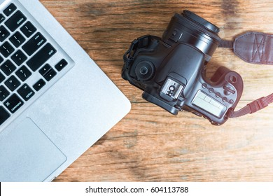 Photographer journalist camera photo on wooden table. Freelance designer photography concept