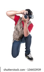 photographer kneeling on white background