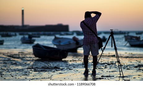 Photographer at la Caleta Beach Cadiz Spain