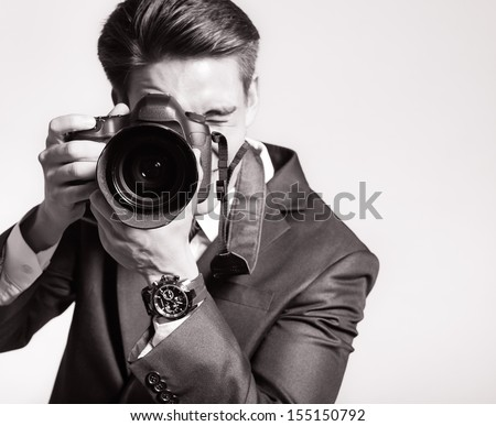 Photographer man is using professional camera