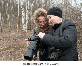 photographer and model in nature in spring.