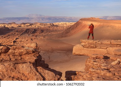 Photographer in the Moon Valley (Valle de la Luna), Atacama Desert, Chile