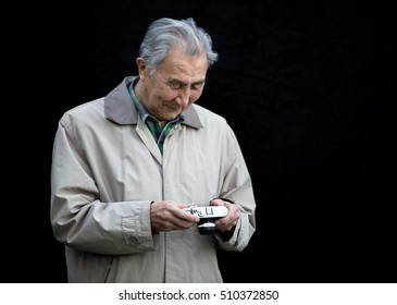 photographer, an old man with a camera