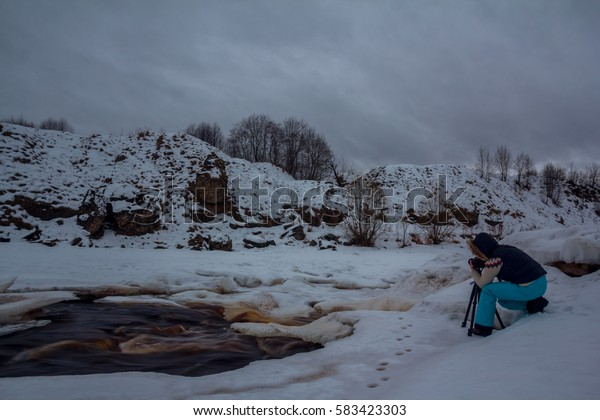 the photographer on the banks of the river, Leningrad oblast, Russia