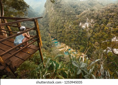Photographer on the lookout point on the Cascades National Park in Guatemala Semuc Champey.