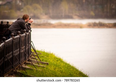 Photographer on the river bank