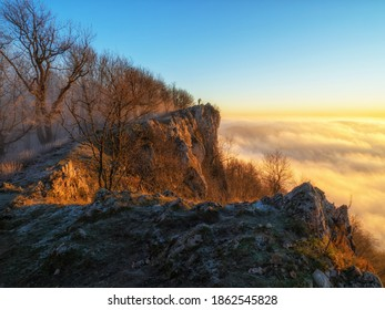 Photographer on the rocky hill in the morning light