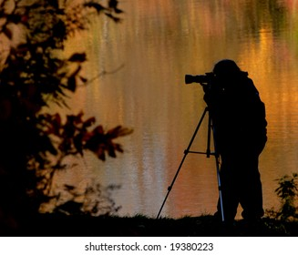 A photographer out capturing the fall colors.