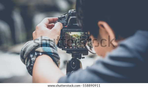 The photographer to pay close attention to take a photo. (vintage style)