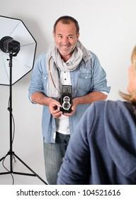 Photographer in photo session in studio