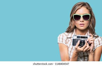 photographer with polaroid, pictures, photo studio