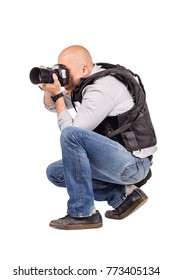 photographer with a professional camera. Isolated on white background