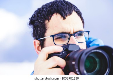 Photographer ready for shooting during trekking in the forest