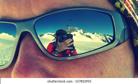 Photographer reflected on sunglasses while climbing Mönch mountain in the Alps, Switzerland