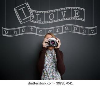 Photographer with retro photo camera, concept I love photography