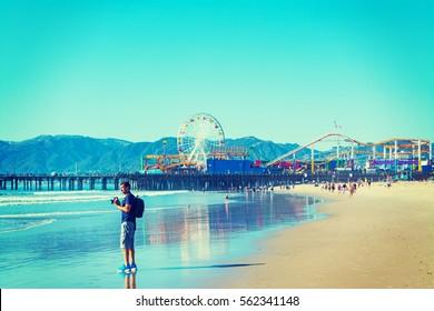 Photographer in Santa Monica beach, California