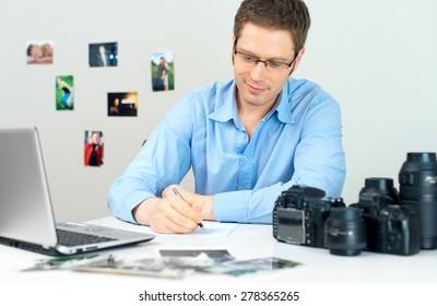 Photographer selecting photos on his computer.