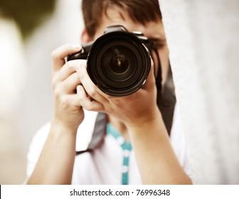 Photographer, selective focus point on nearest part of lens