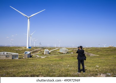 A photographer shoot wind turbines