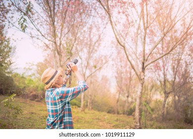photographer shooting in the forest with nature beautiful background