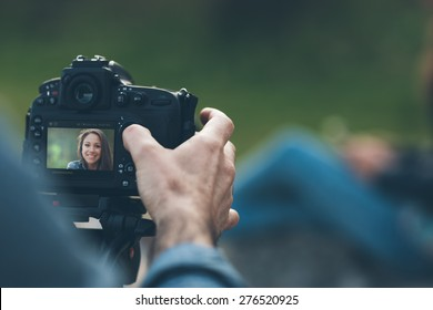 Photographer shooting hands close up and model posing on background