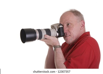A photographer shooting an SLR camera with a nice zoom lens