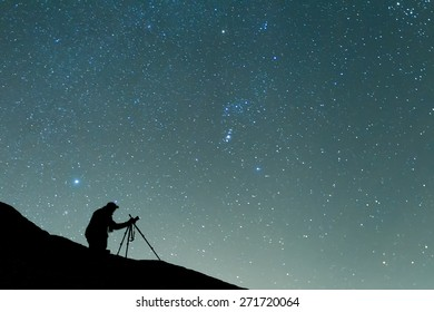 photographer shooting the starry sky seen from Meteora, Greece