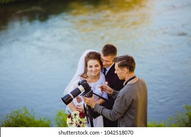 Photographer showing the bride and groom had just taken photos