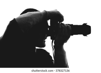 Photographer silhouette isolated on white background