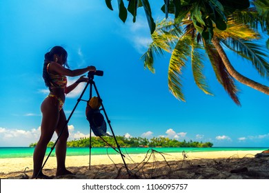 photographer silhouette people make a photo of nature landscape for PhotoStocks and social networks