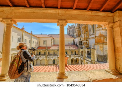 Photographer with stabilizer and professional camera takes photos at cloister of Santa Barbara. The Convent of Christ is a Templar Castle in Tomar, Portugal, Tomar. Aerial view of Monastery.