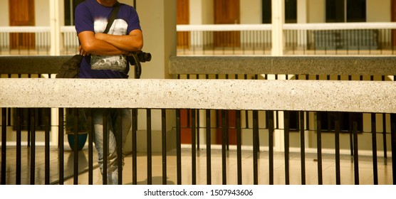 Photographer standing behind a protection wall of a building