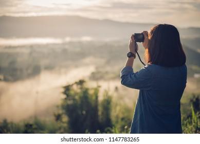 Photographer take a picture at Mountain with foggy sunrise. View from the scenic Khao Takian Ngo-Khao Kho-Phetchabun Thai land.