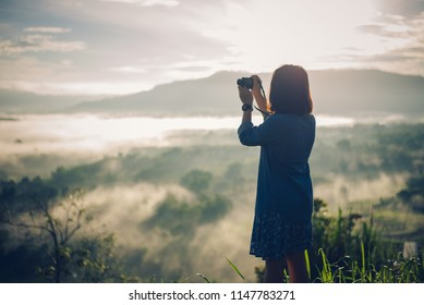 Photographer take a picture at Mountain with foggy sunrise. View from the scenic Khao Takian Ngo-Khao Kho-Phetchabun Thai land.