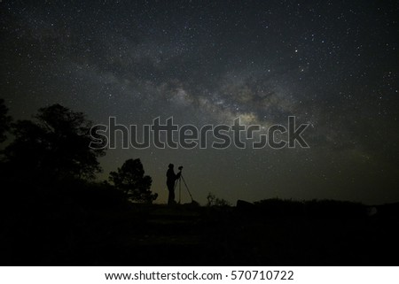 Photographer takes a good shot on the Milky way. Long exposure photograph