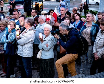 "Photographer takes photo of Polish old protesters gathered in Poznan in Poland for candlelit vigils as the law passed, chanting ""Free Courts"", Poznan, 28 Aug 2017."