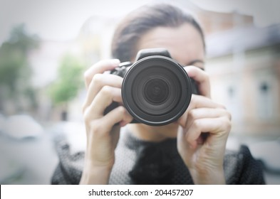 Photographer takes pictures in the open air
