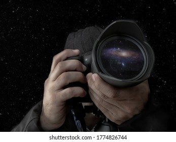 photographer taking a night shot of the stars with the lens and hands in the foreground