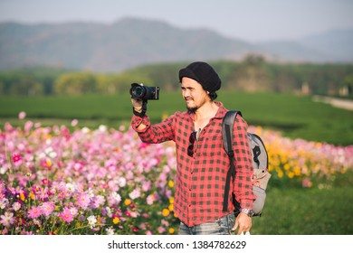 photographer taking photo of flowers mountain, landscape