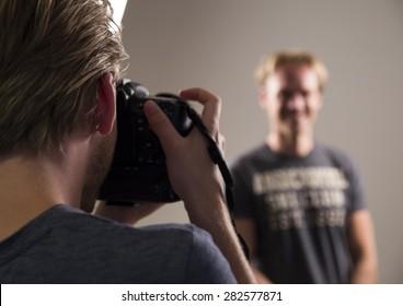 Photographer taking photo of male model