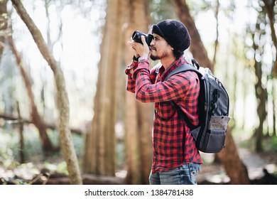 photographer taking photo of the mountain