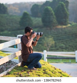 photographer taking photo of the moutain