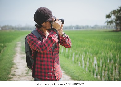 photographer taking photo of the rice field