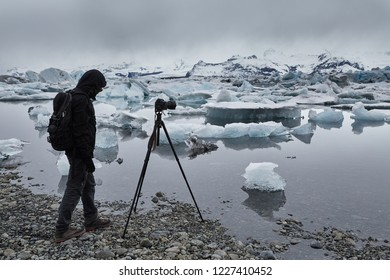 Photographer taking photos of a glacier in iceland