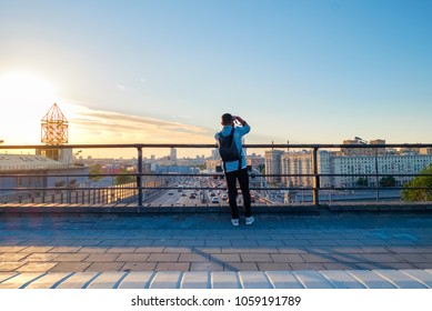 Photographer taking picture above Moscow cityscape with Third Transport Ring road and modern architecture of Moscow City Business Center, Russia.