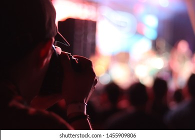 photographer taking picture at a festival concert